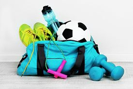 picture of zipper  - Sports bag with sports equipment in room - JPG