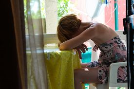 picture of post-teen  - Young Female Covering Her Face With Her Hands - JPG