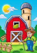 Big Red Barn With Farmer