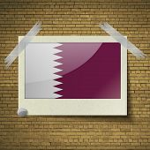 stock photo of qatar  - Flags of Qatar at frame on a brick background - JPG