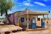 Постер, плакат: Old Abandoned Gas Station in Desert