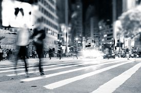 picture of street-art  - Blurred image of people moving in crowded night city street - JPG