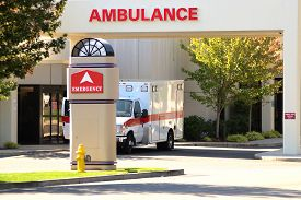 pic of ambulance  - Ambulance sitting at the door of an emergency room at a hospital - JPG