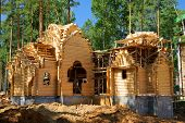 stock photo of longhouse  - Building of the new log house - JPG