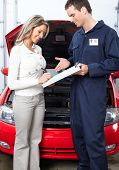 picture of car repair shop  - Handsome mechanic working in auto repair shop - JPG