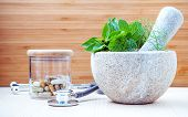 Alternative Health Care And Herbal Medicine .fresh Herbs And Herbal Capsule With Mortar And Pestle. poster