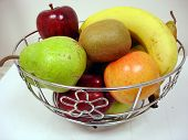 picture of fruit bowl  - Lovely fresh fruit appealingly displayed in metal fruit bowl - JPG