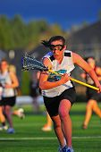Girls Lacrosse race after the ball