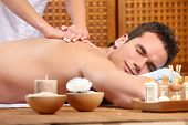 young handsome man getting a massage. Spa