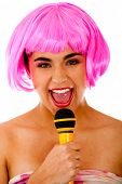 Eccentric woman singing with microphone and pink wig - isolated over white