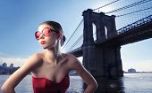 Beautiful woman with Brooklyn Bridge on the background