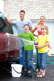 stock photo of car wash  - Smiling happy family washing the family car - JPG