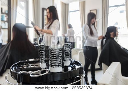poster of Two Professional Hairdressers Working With Customers In Beauty Salon