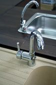 Two Kitchen Faucets With Stainless Steel Sink