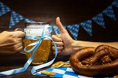 October Fest Concept. Wooden Table In Pub Hands With Mug Pint Glass Cup Of Beer With Blue Tape, Snac poster