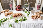 Candy Bar. Fresh Fruit In Envelope On Banquet Table At Business Or Wedding Event Venue. Self Service poster