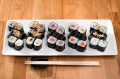 Maki Sushi Rolls With Salmon, Tuna, Eel And  Avocado On A White Plate. Close Up. Japanese Food Resta poster