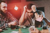 Young Friends Playing Poker On Party At Home. Playing Games. Indoor Fun. Young Girl. Young Guy. Sitt poster
