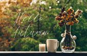 Hello Autumn. Cozy Autumn Still Life: Cup Of Hot Coffee With Autumn Bouquet Of Flowers On Vintage Wi poster