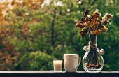 Cozy Autumn Still Life: Cup Of Hot Coffee With Autumn Bouquet Of Flowers On Vintage Windowsill With  poster