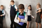 Children bullying their classmate indoors poster