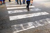 Pedestrians Crossing. Many Legs Of People Crossing The Zebra Crossing poster