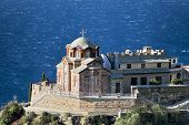 Greek Orthodox Church On A Rock Above The Sea