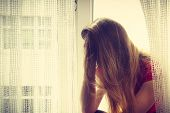 Anxiety And Potential Problems Concept. Sad, Unhappy Worried Brunette Woman Sitting On Windowsill Th poster