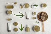 Flat Lay Composition With Hemp Lotion On White Wooden Background poster