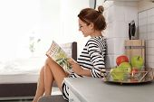 Beautiful Young Woman Reading Magazine At Home. Lazy Morning poster