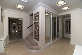 Mirror Wardrobe In The Hallway With A Light Parquet poster