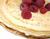 Pancakes pile with raspberry fruits