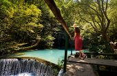 Girl Enjoying Day Outdoors At A Natural Water Well poster