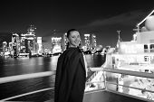 Business Woman Smile In Suit Jacket In Miami, Usa. Sensual Woman On Ship Board On Night Skyline. Fas poster