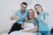 Happy Family In Clinic. Young And Old People In Hospital. Care Young People About Old Man. Health Ol poster