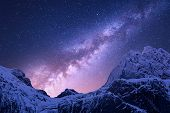 Milky Way Above Snowy Mountains. Space. Fantastic View With Snow Covered Rocks And Starry Sky At Nig poster