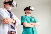 Portrait Of Doctor Team Are Using Virtual Reality Technology To Examination Physical Body Patient.,  poster