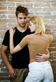 Sexy Young Couple. Couple In Love. Fashion Couple In Trendy Clothes. Sensual Man&woman Hugging. Life poster