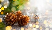 Christmas concept with silver bauble, fir cones and festive fir tree poster