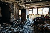 Burnt House Interior. Burned Room In Industrial Building, Charred Furniture And Damaged Apartment Af poster