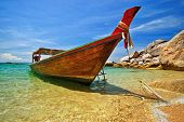 Longtail boat anchored at a beach