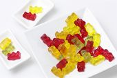 stock photo of jelly babies sugar  - multi colored jelly babys on plate - JPG