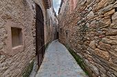 Narrow passageway between two walls in Peratallada, Spain