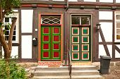 Colorful doors of half-timbered houses in Bavaria (Germany)