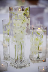 stock photo of wedding table decor  - Flower and candle decoration for a wedding - JPG