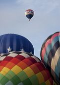 READINGTON, NJ-JUL 29: Hot air balloons on the field of the launch area preparing to ascend at the Q