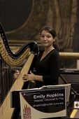 NEW YORK-JUL 28: A portrait of harpist Emily Hopkins in Penn Station on July 28, 2012 in New York, N
