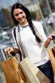 Image of happy female with paperbags after shopping