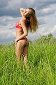 The beautiful girl in underwear in field