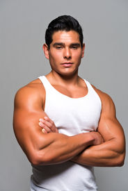 picture of wife-beater  - Athletic young man in a white undershirt - JPG